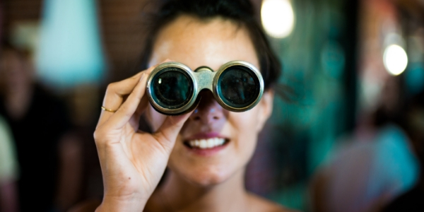 Photo of woman searching with binoculars