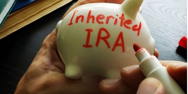 Inherited IRA written on a piggy bank | Inherit an IRA or 401k